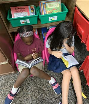 Young students reading comfortably
